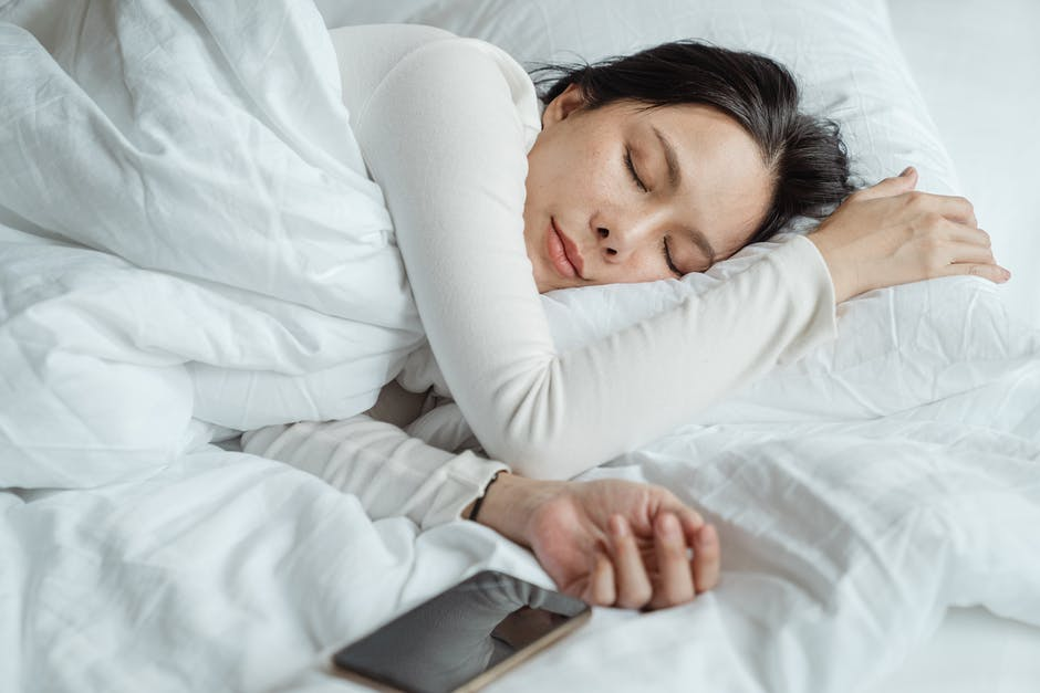 A person lying on a bed